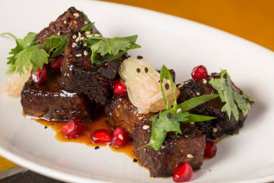 Honey Glazed Short Ribs With Pomelos, Scallions, Sesame Seeds $178